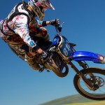 Motocross rider flys in the air